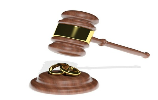 Gavel Coming Down On Wedding Rings